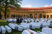 Elegant table settings for the formal ball in the castle gardens, hosted by Erlangen University, Erlangen, Franconia, Bavaria, Germany