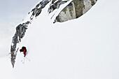 Man downhill skiing in deep snow, Marmolata, Trentino, Italy