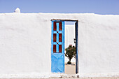 View through a blue door to a inner yard, Dongola, Northern, Sudan