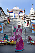 Steps leading up to Jagdish Temple with women in saris selling offerings, Udaipur, Rajasthan, India