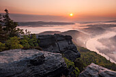 View over a valley with Elbe river in morning mist, Saxon Switzerland, Saxony, Germany