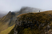 Young woman hiking in fog, Quiraing, Trotternish peninsula, Isle of Skye, Scotland, United Kingdom