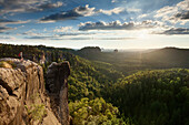 Young woman on Domerker looking at view, Saxon Switzerland National Park, Saxony, Germany