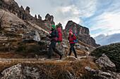 Young couple hiking, Sexten Dolomites, Belluno, Veneto, Italy