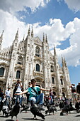 Doves at Piazza del Duomo with Milan Cathedral in the background, Milan, Lombardy, Italy