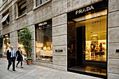 Couple window shopping, Via dell Spiga, Golden Triangle, Milan, Lombardy, Italy