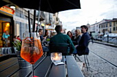 Aperitive served in a bar, Navigli quarter, Milan, Lombardy, Italy