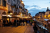 Restaurants and bars along a canal in the evening, Navigli quarter, Milan, Lombardy, Italy