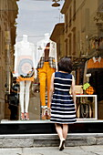 Woman window shopping, Via dell Spiga, Golden Triangle, Milan, Lombardy, Italy