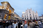 Public concert at Piazza del Duomo with Milan Cathedral and Galleria Vittorio Emanuele II in the evening, Milan, Lombardy, Italy