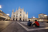 Piazza del Duomo with Milan Cathedral and Palazzo dell Arengario in the evening, Milan, Lombardy, Italy