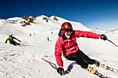 Skiers downhill skiing, Lavoz, Lenzerheide, Canton of Graubuenden, Switzerland