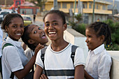 Cheerful girls in school uniform on the way home from school, Taolanaro (Fort Dauphin), Toliara, Madagascar, Indian Ocean