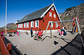 Children play outside a primary school, Sisimiut (Holsteinsborg), Kitaa, Greenland