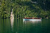 Excursion boat at Schrainbach waterfall, Koenigssee, Berchtesgaden region, Berchtesgaden National Park, Upper Bavaria, Germany