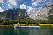 Excursion boat at Koenigssee, Watzmann east wall in the background,  Berchtesgaden region, Berchtesgaden National Park, Upper Bavaria, Germany