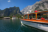 Excursion boat in front of baroque style pilgrimage church St Bartholomae, Watzmann east wall in the background, Koenigssee, Berchtesgaden region, Berchtesgaden National Park, Upper Bavaria, Germany
