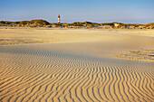 Lighthouse in the dunes at the beach, Kniepsand, Amrum island, North Sea, North Friesland, Schleswig-Holstein, Germany