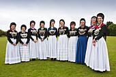 Women in traditional frisian costumes, Nebel, Amrum island, North Sea, North Friesland, Schleswig-Holstein, Germany