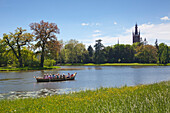 Boat trip on the lake, view to church of St Petri, Woerlitz, UNESCO world heritage Garden Kingdom of Dessau-Woerlitz, Saxony-Anhalt, Germany