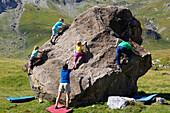 Children and adults bouldering, climbing, Engstligenalp, Bernese Oberland, Switzerland