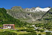 Alpine hut Alpenrose in front of Vierte Hornspitze and Dritte Hornspitze, Zillertal Alps, valley Zillertal, Tyrol, Austria