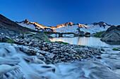 Mountain river flowing into lake Schwarzsee, Dritte Hornspitze, Turnerkamp and Grosser Moeseler in background, Zillertal Alps, valley Zillertal, Tyrol, Austria