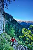 Woman ascending to Hoher Goell, Berchtesgaden National Park, Berchtesgaden Alps, Upper Bavaria, Bavaria, Germany