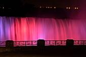 Nighttime at Niagara Falls- Coloured spotlights on the Canadian Falls, Niagara Falls, Ontario, Canada