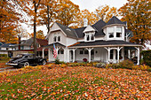 A Colonial home with fall foliage color in Petoskey, Michigan, USA