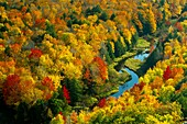 The Porcupine Mountains State Park and the Ontonagon River with fall foliage color from the Lake of the Clouds overlook near Ontonagon, Michigan, USA
