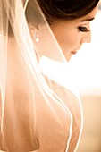 gorgeous bride preparing and anticipating her wedding after hair, makeup, veil, wedding dress are perfect