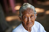 Portrait of an elderly burmese woman  Kyauktan town  Thanlyin District, Yangon Division  Myanmar