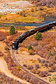 Durango and Silverton Narrow Gauge Railroad train departing Silverton, Colorado USA