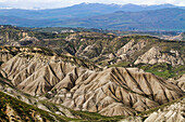 Calanchi del Cannizzola, a geological formation known as Badlands where softer sedimentary rocks and clay soils have been eroded by wind and water near Centuripe, Sicily, Italy