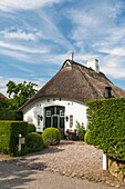 Traditional house with thatched roof in Sieseby, Schleswig-Holstein, Germany, Europe