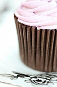 a truly gorgeous cup cake with pink swirl icing