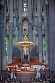 Mass,Interior of Basilica Sagrada Familia,altar and apse, Barcelona, Catalonia, Spain