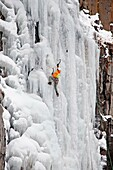 Elijah Weber ice climbing Palisade Falls which is rated WI-4 and located in Hyalite Canyon in the Gallatin Mountains near the city of Bozeman in southern Montana