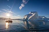 Zodiacs from the Lindblad Expeditions ship National Geographic Explorer amongst grounded icebergs near Rode O Red Island, Scoresbysund, Northeast Greenland