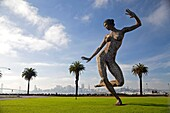 Bliss Dance, a 40-foot statue of a naked dancing woman by sculptor Marco Cochrane on Treasure Island, San Francisco, California, United States of America, USA