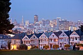 Victorian houses Painted Ladies at Alamo Square and the Skyline of San Francisco at night, California, United States of America, USA
