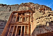 Al Khazneh The Treasury, Petra, Jordan  It is one of the most elaborate temples in the ancient Jordanian city of Petra  As with most of the other buildings in this ancient town, this structure was also carved out of a sandstone rock face  It has classical