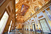 The Throne Room is nearly 40 meters long and was completed in 1845  On the back wall is placed a portable guilder throne  The decorations symbolise absolute power  The architrave in the room is decorated with portraits of the sovereigns of Naples stating