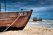 Two Fishing boats at the beach of the Baltic Sea, near the pier of the Baltic Sea resort of Ahlbeck, Municipality of Heringsdorf, Usedom Island, County Vorpommern-Greifswald, Mecklenburg-Western Pomerania, Germany, Europe, No Property Release available!
