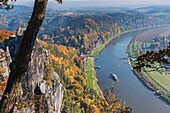 View from the spectacular rock formation Bastei (Bastion) to health resort Rathen and the Elbe River. The Bastei is one of the most visited tourist attractions in the national park Saxon Switzerland, municipality Lohmen, near Dresden, Saxony, Germany, Eur