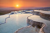 Pamukkale, Turkey - the limestone terraces left by the flowing water, view at sunset time Pamukkale near Denizli