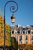 Lamps and achitecture in Place des Vosge - the oldest public square in Paris, Ile-de-France, France