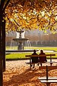 Two friends enjoying the morning in Place des Vosges in the Marais District, Paris, Ile-de-France France