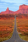 One of the most famous images of the Monument Valley is the long straight road US 163leading across flat desert towards sandstone buttes and pinnacles rock  Monument Valley Tribal Park, Nabajo Nation, Arizona/Utah, USA